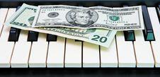 Free Dollar Bills On Electric Organ Keyboard Royalty Free Stock Images - 9738249