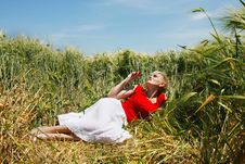 Young Attractive Woman Dreaming In Field Stock Image