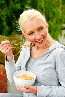 Free Young Woman Eating A Bowl Of Cereal Royalty Free Stock Photos - 9739738