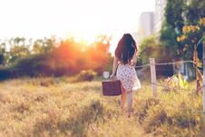 Free Woman In Brown Floral Dress Walking Near Fence Royalty Free Stock Photos - 97381818