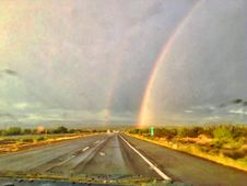 Free Drive Until You Pass Between The Rainbows Stock Image - 97382131
