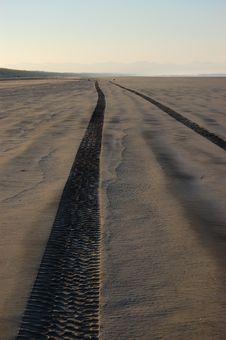 Tire Tracks On Sandy Beach Royalty Free Stock Photos