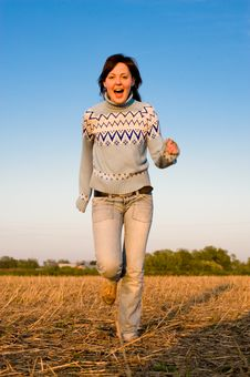 Free Happy Young Woman Running Royalty Free Stock Photo - 9741865