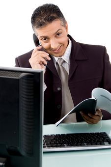 Free Front View Of Smiling Businessman Busy On Phone Stock Images - 9743114