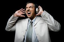 Free Side View Of Businessman Listening Music Stock Images - 9743144
