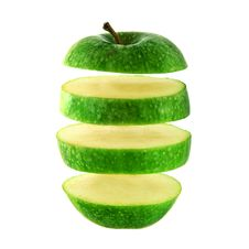 Free Green Apple Cut Into Slices Stock Photos - 9743383