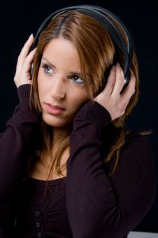 Free Portrait Of Young Woman Listening Music Stock Photos - 9743513