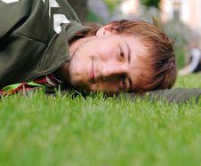 Free Man Lying On Green Grass Stock Photography - 9743752