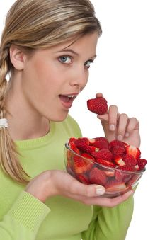 Healthy Lifestyle Series - Woman Eating Strawberry Royalty Free Stock Photos
