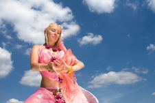 A Woman Dancing And A Blue Sky Stock Photos