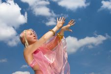 A Woman In Asian Dress Danccing And A Blue Sky Royalty Free Stock Photo