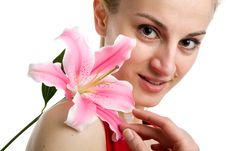 Free Nice Girl With A Pink Lily Stock Photo - 9745240