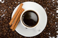 Free Cup Of Coffee And Coffee Beans Royalty Free Stock Image - 9745586