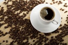 Cup Of Coffee And Roasted Beans Stock Photo