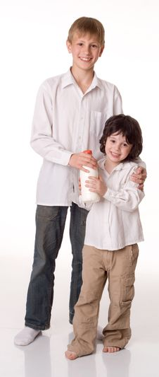 Free Two Brothers With A Bottle Of Milk Royalty Free Stock Image - 9746076
