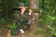 Free Man In A Camouflage Shoots From A Grenade Launcher Stock Image - 9747291