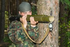 Free Man In A Camouflage Shoots From A Grenade Launcher Stock Photos - 9747323