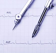 Free EKG Printout And Compasses Royalty Free Stock Images - 9747799