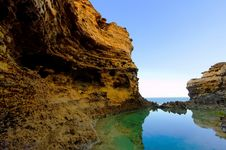 Free Cliff And Water With Reflections Stock Image - 9748241
