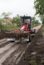 Free Grader Working On New Street Stock Photography - 9751982