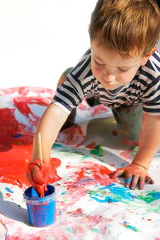 Young Boy Painting Stock Photo
