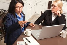 Free Businesswomen Working On The Laptop Stock Photo - 9752550