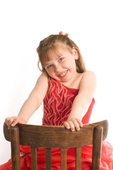 Free Girl On Brown Chair Stock Image - 9754641