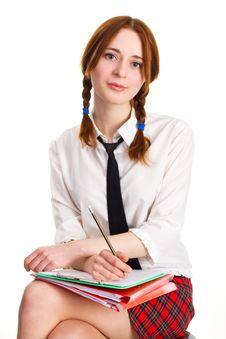 Beautiful Lady Writing On A Worksheet Royalty Free Stock Image