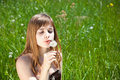 Free Young Girl Blowing On Dandelion Royalty Free Stock Photo - 9767405