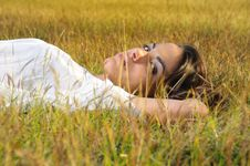 Free Girl Relaxing On The Grass Royalty Free Stock Photo - 9763225