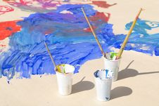 Used Paint Brushes Of Different Colors And Paper Royalty Free Stock Photos