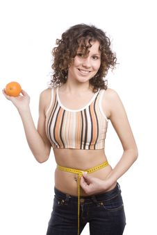 Smiling Fit Woman With Measure Tape And Orange. Royalty Free Stock Images