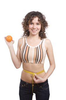 Smiling Fit Woman With Measure Tape And Orange. Stock Images
