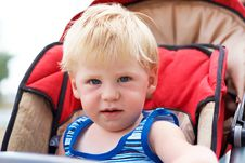 Free The Little Boy Sits In A Children S Carriage Stock Photography - 9768152