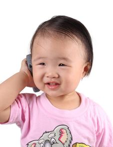 Free Asian Kid With Phone Stock Photo - 9769950