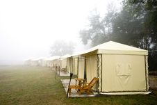 Yellow Tent In Foggy Morning Royalty Free Stock Photos