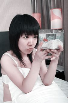 Free Asian Girl With Her Goldfish Stock Images - 9770924