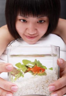 Asian Girl With Her Goldfish Royalty Free Stock Image