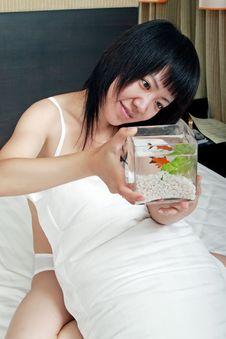 Asian Girl With Her Goldfish Stock Photos