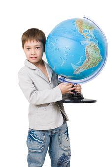 A 6 Y.o. Boy With A Globe Stock Photo