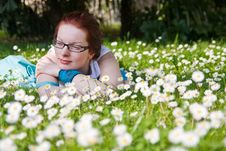 Young Woman Laying On Grass Stock Image