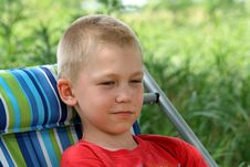 Free Boy In An Armchair Stock Images - 9774994