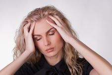 Free A Shot Of A Girl With A Headache Stock Image - 9775521