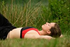 Sportive Young Adult Resting In The Grass Stock Photography