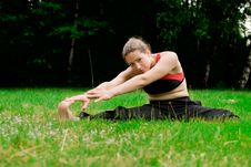 Free Practising Yoga In A Green Field With Trees Royalty Free Stock Photo - 9777885