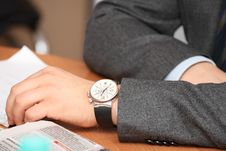 Men S Hands With Watches On The Table Royalty Free Stock Photography
