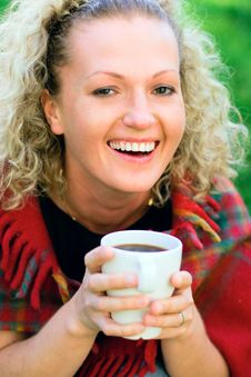 Free Woman Holding A Cup Stock Photography - 9779922