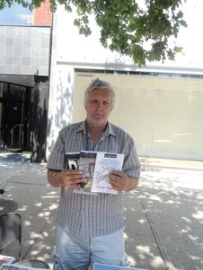 Free Journalist Nebojsa Knevic Holds Up Three Of The Books He Authored, 2017 08 09 Royalty Free Stock Photography - 97787847