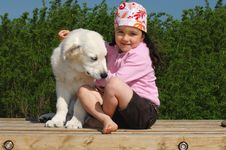 Free Little Girl With A Golden Retriever Stock Image - 9780091