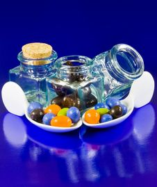 Free Crystal Bottles And White Spoons With Chocolate Royalty Free Stock Image - 9780816